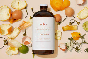 Veles All Purpose Cleaner Refill with a Background of Food Waste