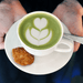 organic matcha latte in white cup with cookie