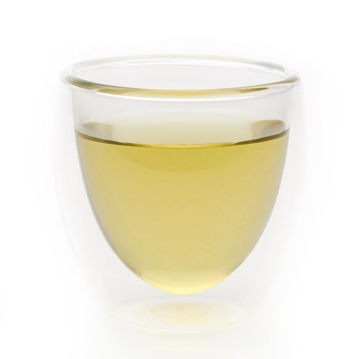steeped kamairicha green tea in glass cup