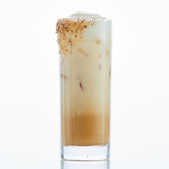 iced masala chai latte with cinnamon sugar in highball glass