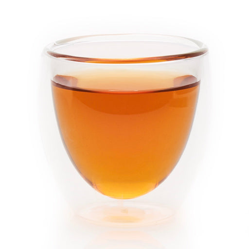 steeped Just Peachy black tea in glass cup