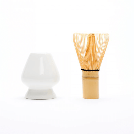 Matcha whisk (chasen) beside whisk stand