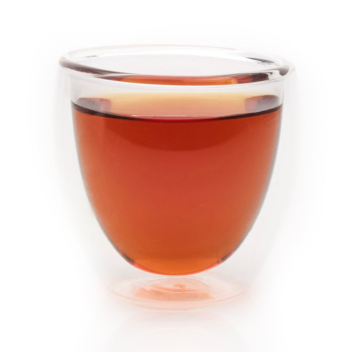 steeped Earl Grey Cream rooibos tea in glass cup