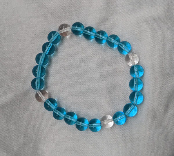 Unisex sky blue clear glass beads with elastic band size 8mm