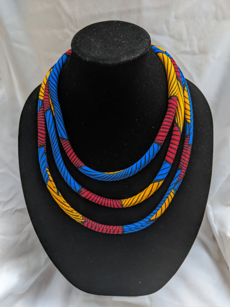 Blue red gold yellow black African Print Ankara cotton Fabric material magnetic tri-layer necklace. Matching earrings, bracelets and clutch bag sold separately.
