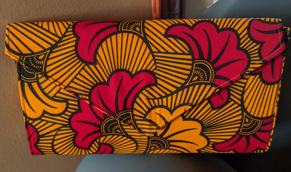 Red Yellow black Flowers African Print Ankara cotton Fabric material Clutch bag. Matching earrings, bracelet and necklace sold separately.