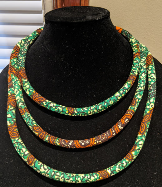 green burnt orange brown African Print Ankara cotton Fabric material magnetic tri-layer necklace. Matching earrings, bracelets and clutch bag sold separately.