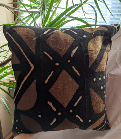 Traditional Authentic Genuine African Mud Cloth Pillow 3. Design one side and other side plain black No two pieces of mud cloth are exactly alike, but the exact patterns vary from one piece to the next brown off white
