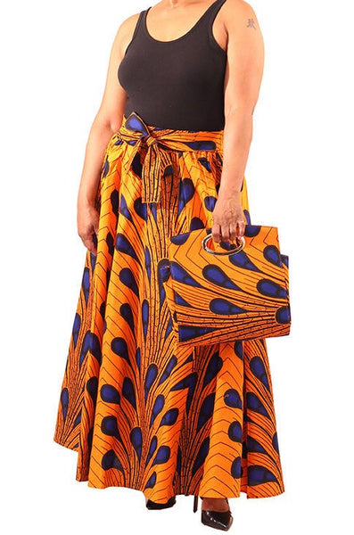 Ankara cotton fabric blue gold Peacock handbag. Matching maxi skirt with attached belt and face mask sold separately.
