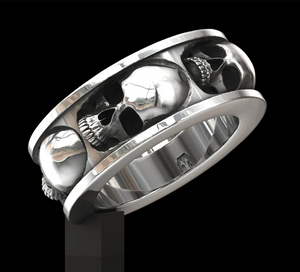In the belly of the beast skull ring & Five skull band ring