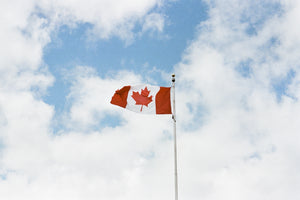 Canadian flag against a blue sky