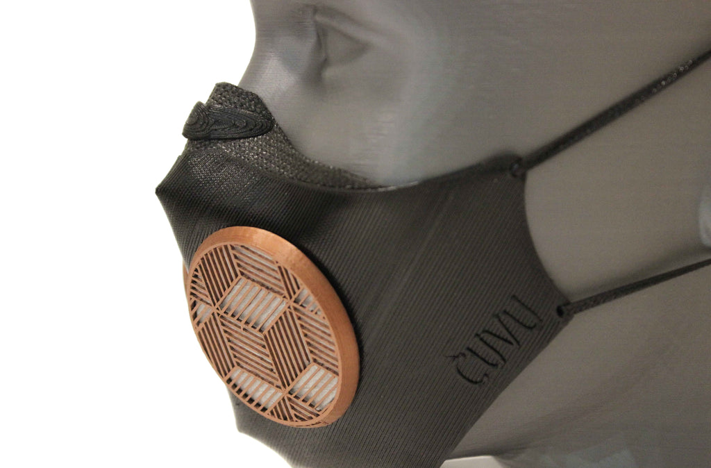 CUVU Revolution Anti-Pollution mask with unique straight line side profile, black TPU body and top neoprene trim along cheeks - elegant with copper infused filtered air ports
