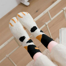 Load image into Gallery viewer, topdown view of a model wearing the black and orange dot paw socks