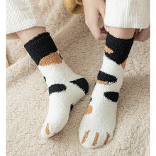 Load image into Gallery viewer, top down view of a model wearing the black and orange dot paw socks