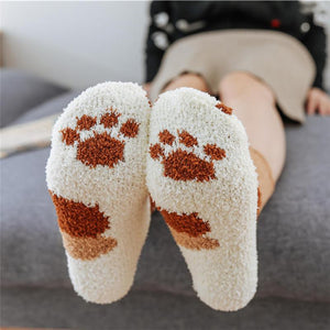 bottom view of a model wearing the brown dot paw socks