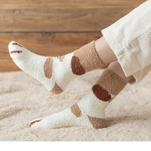 side shot of a model wearing the brown spot paw socks