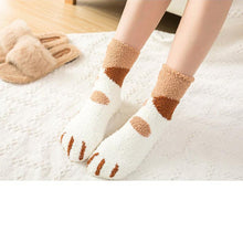 Load image into Gallery viewer, top down view of a model wearing the brown spot paw socks
