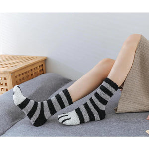 side shot of a model wearing the black stripes paw socks