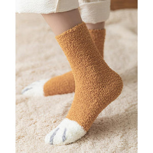 Side shot of a model wearing the orange paw socks