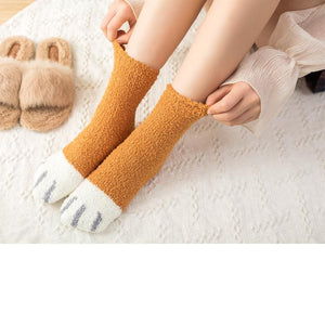 top down view of a model wearing the orange paw socks