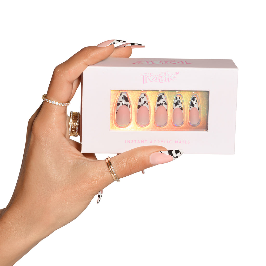Hand wearing Big Moood ballerina holding pink product box with Big Moood nails ballerina shape inside