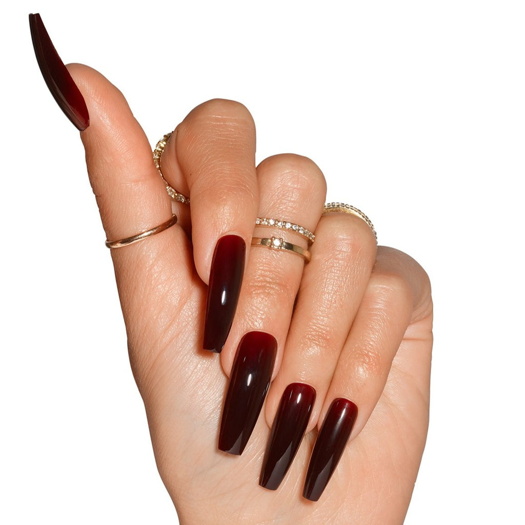 Hand wearing Cherry Cola, dark red jelly nails in coffin shape ultra long length