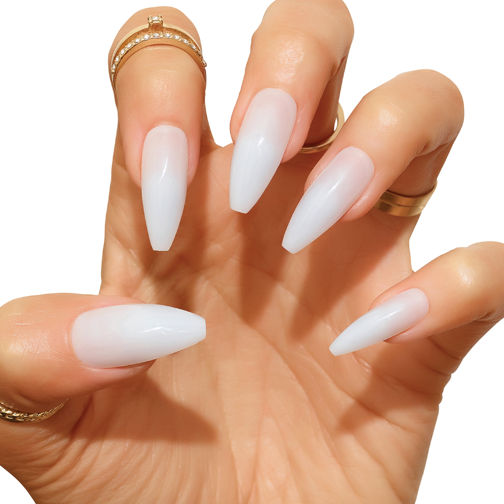 Hand wearing Cream Puff milky jelly acrylic nails in claw pose