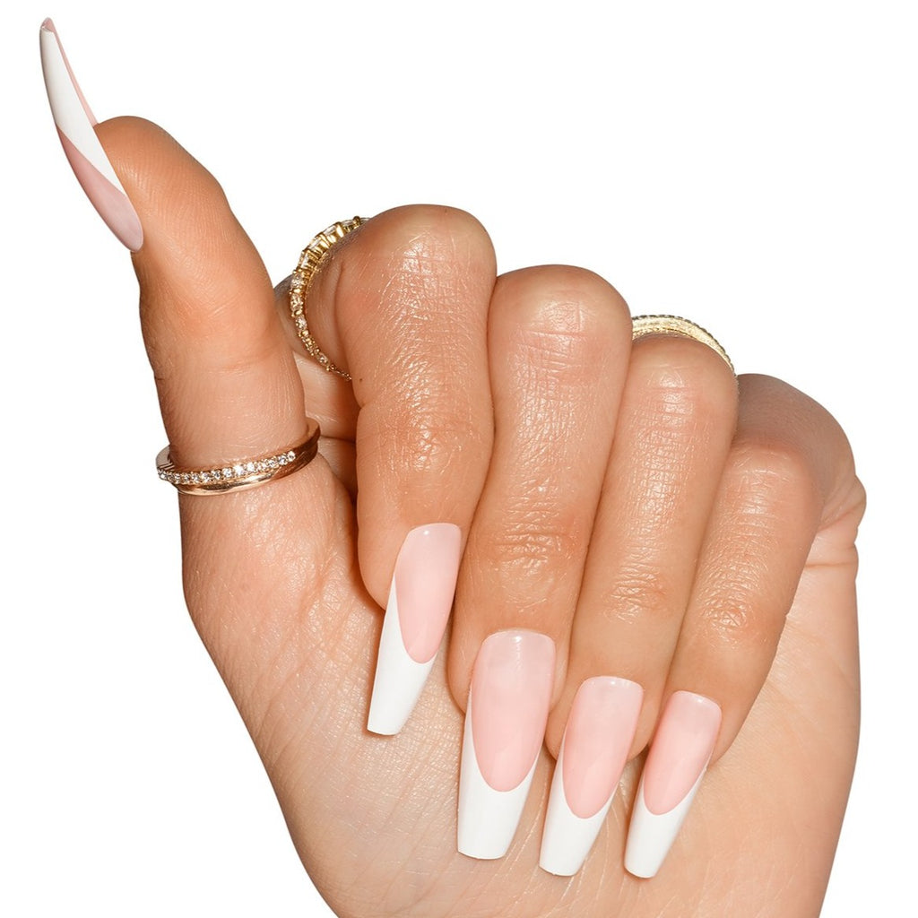 Hand wearing Porn Star nails, natural french tip, in coffin shape ultra long length