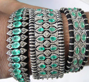 MAHARAJA CUFF WITH EMERALDS AND DIAMONDS