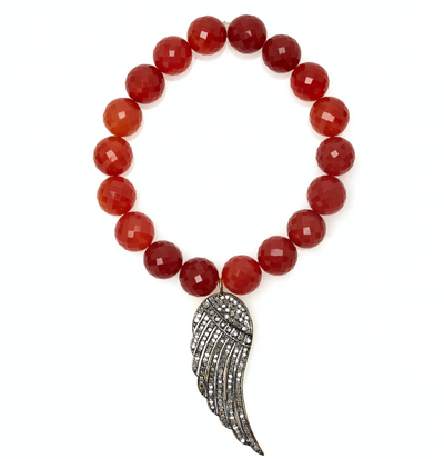 RED ONYX STRETCH BRACELET WITH DIAMOND WING PENDANT.