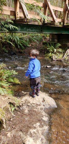 child by river