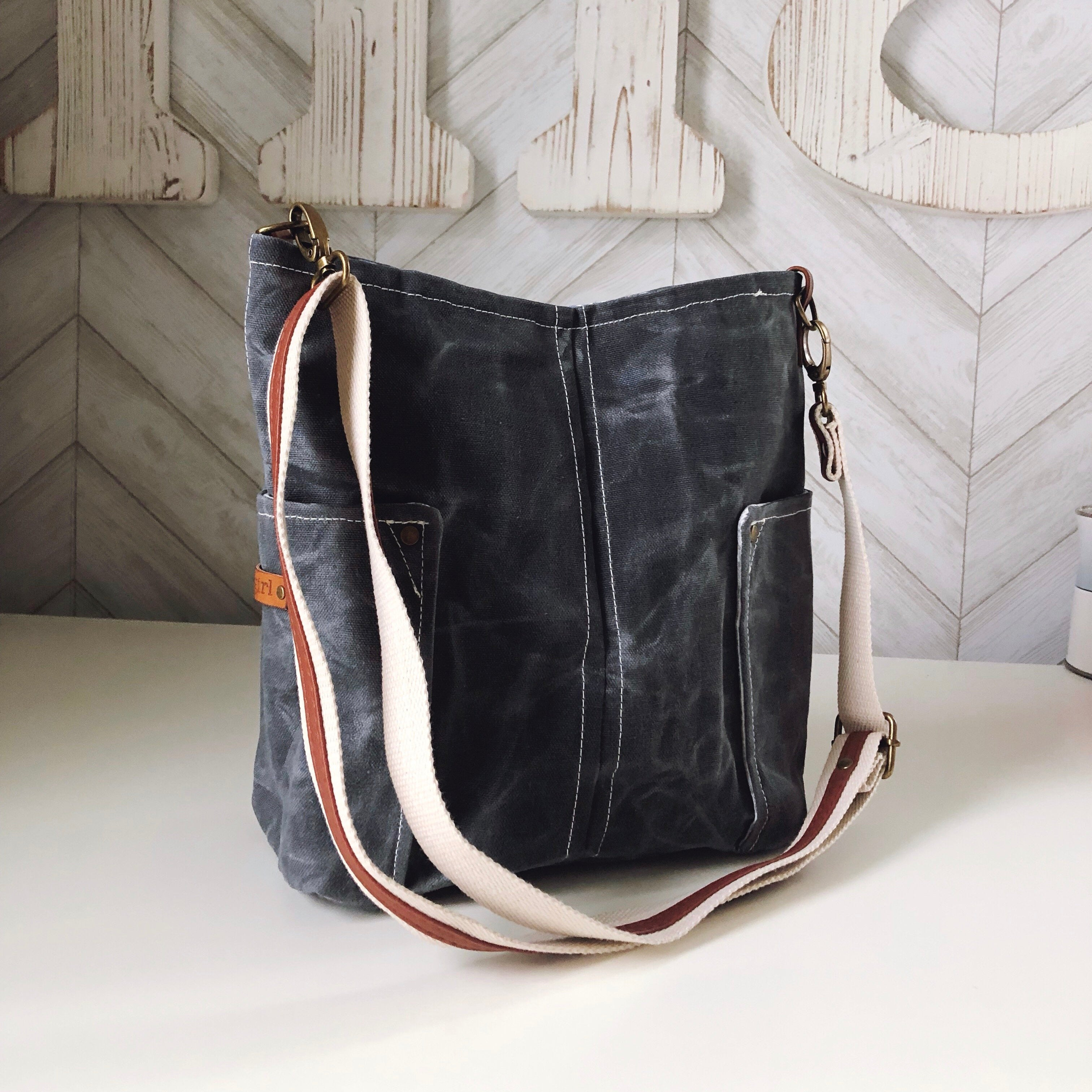Graphite Gray Compass Crossbody