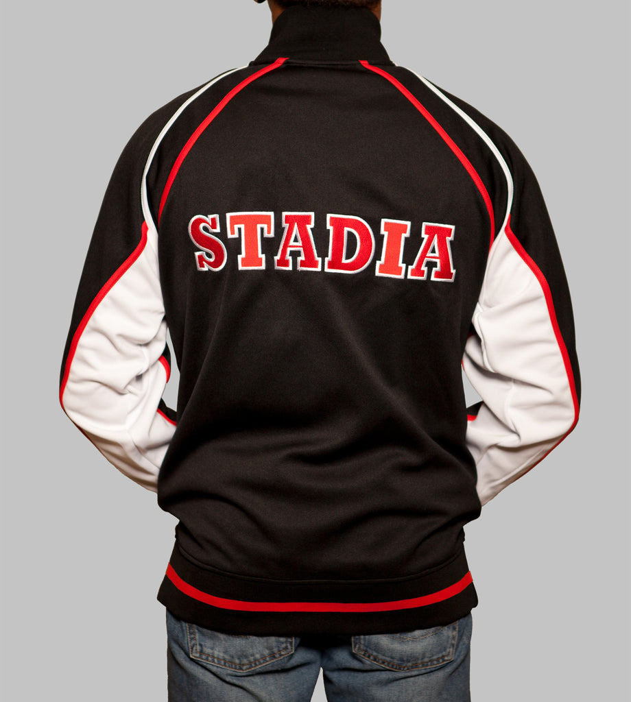 https://cdn.shopify.com/s/files/1/0276/2347/products/STADIA_Olympia-Track-Jacket---Back_1024x1024.jpg?v=1549176368