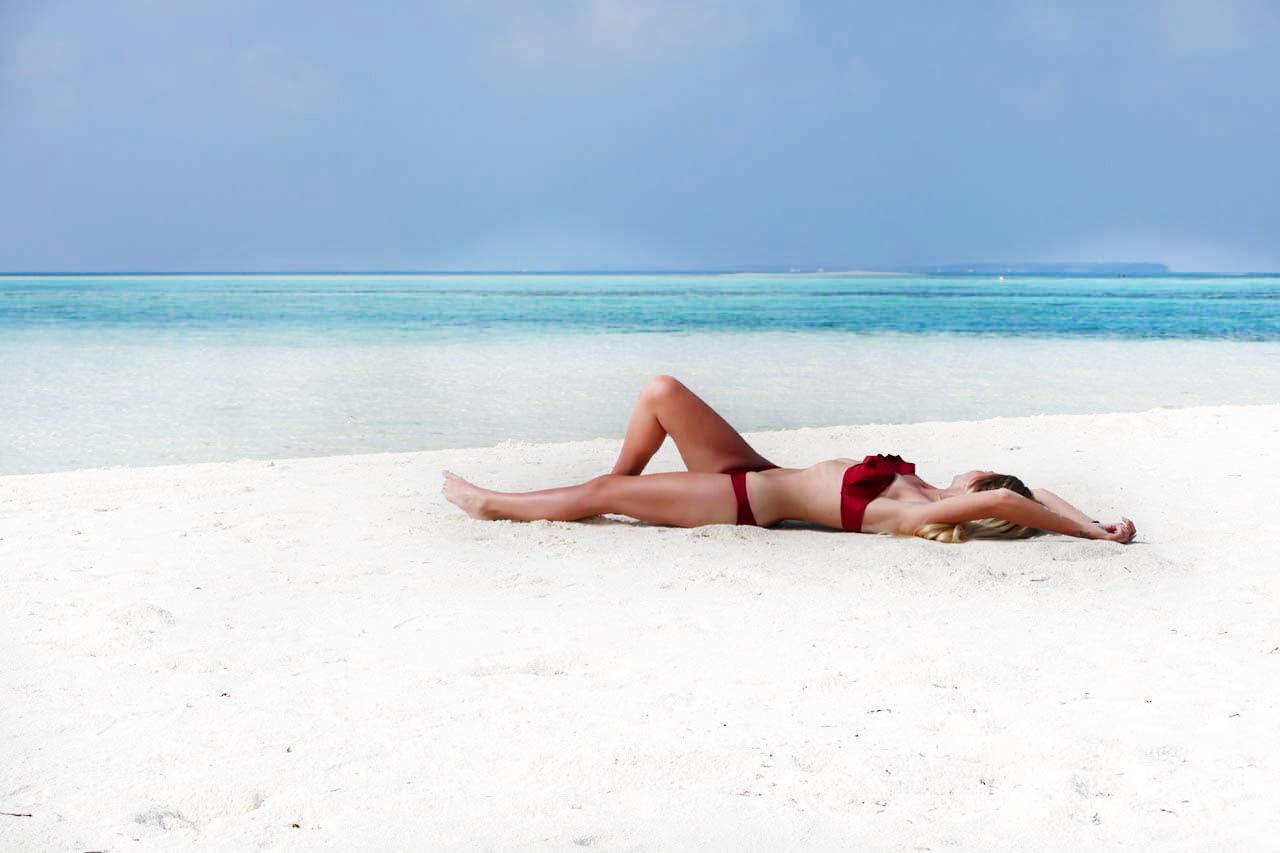 girl laying on beach in formentera