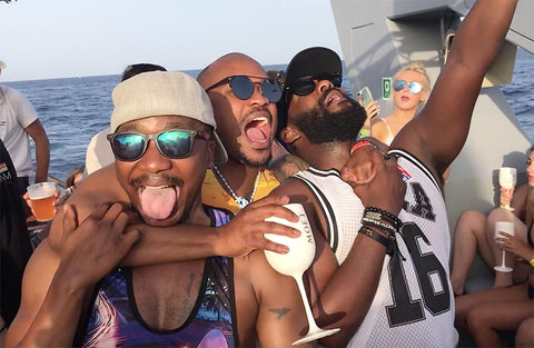 guys on a boat in ibiza with moet