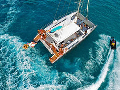 ibiza boat club 70 catamaran drone shot