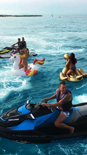 guys on jet skis and floatable toys