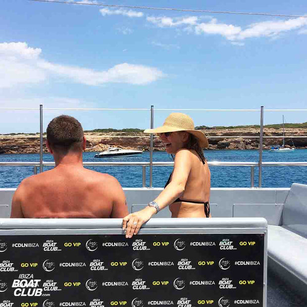 couple laughing with yacht in the background in vip area
