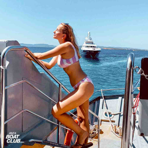 girl with yacht view on ibiza boat club