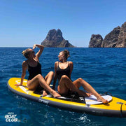 girls having fun on a SUP board in ibiza