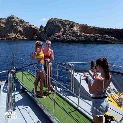 girls taking selfie in formentera