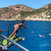 guy jumping from jump board of the ibiza boat club