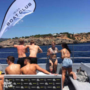 guys enjoying the view in the vip area of the ibiza boat club
