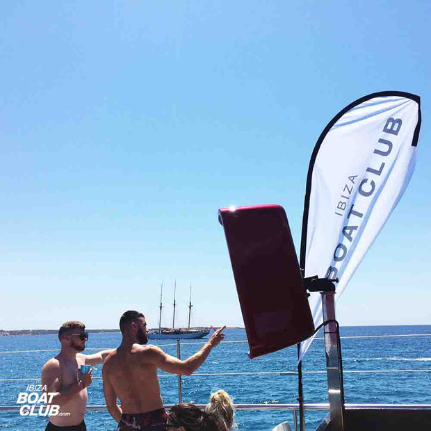 guys pointing on boat on the ibiza boat club