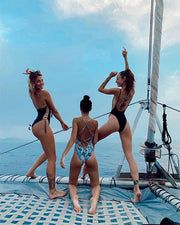 girls posing on a catamaran