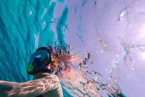 man snorkelling with full face mask in the sea of ibiza