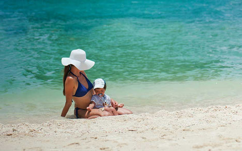 mother on the beach with child