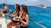 girls eating paella on the boat