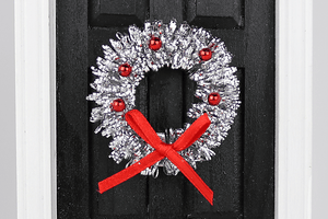 Silver Tinsel Wreath with Red Ornaments