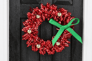 Red Tinsel Wreath with Green and Gold Accents